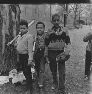 Three boys at a baseball game in Central Park, N.Y.C., 1962