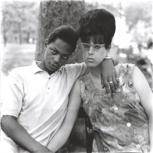A young man and his pregnant wife in Washington Square Park, N.Y.C., 1965