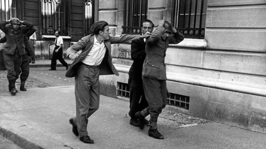 This photograph shows a French civilian who was unable to contain his wrath against a German soldier who had surrendered di Robert Capa