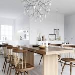 Una tipica sala da pranzo nordica, con tanto bianco e tanto legno