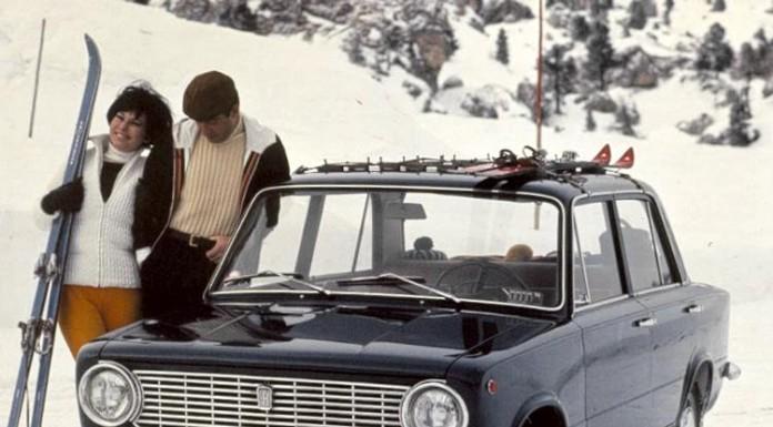 La Fiat 124 in un manifesto pubblicitario d'epoca