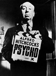 Alfred Hitchcock con il ciak di Psyco