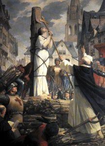 Giovanna d'Arco sul rogo in un dipinto di Jules Eugène Lenepveu