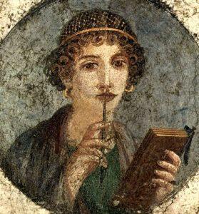 Donna con tavolette cerate e stilo