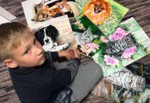 Il bambino russo coi suoi ritratti